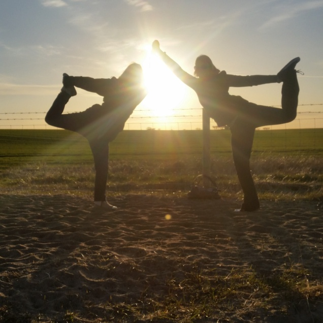 Yoga in a field with Steph